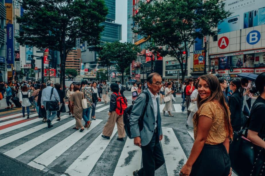Girl walking across Shibuya Crossing in Tokyo, Japan