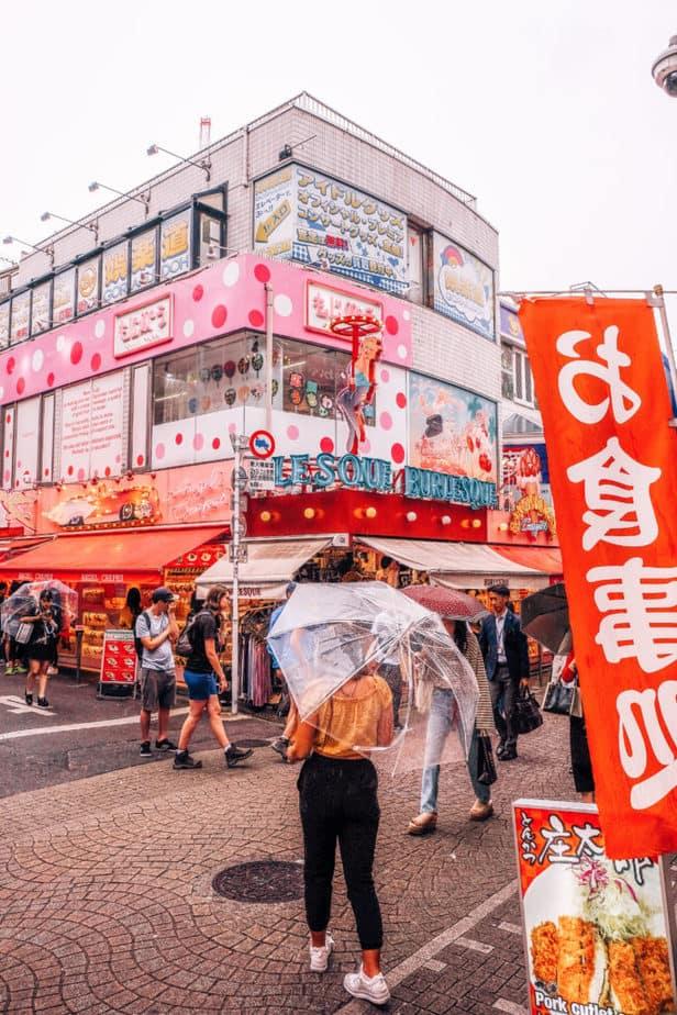A girl with an umbrella on Takeshita street, Tokyo, Japan