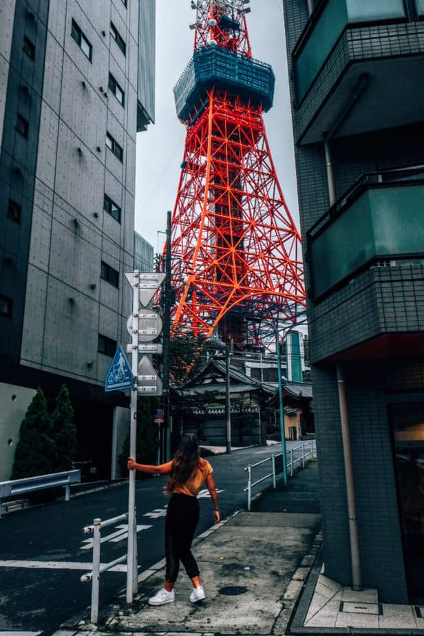 Girl standing in front of Tokyo Tower in Japan