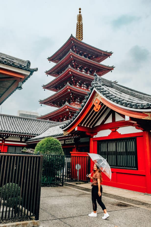 A girl standing in front of Senso-Ji Temple in Tokyo, Japan