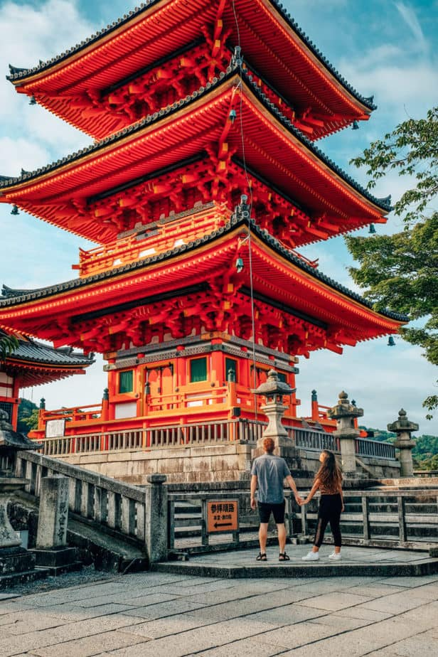 A couple standing in front of Kiyomizu-Dera Temple in Kyoto, Japan