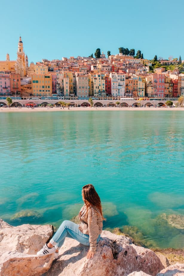 girl sitting in front of Menton, France view