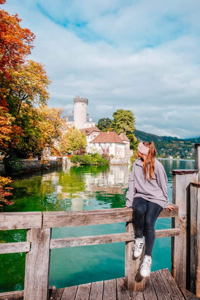 girl in front of castle on Lake Annecy