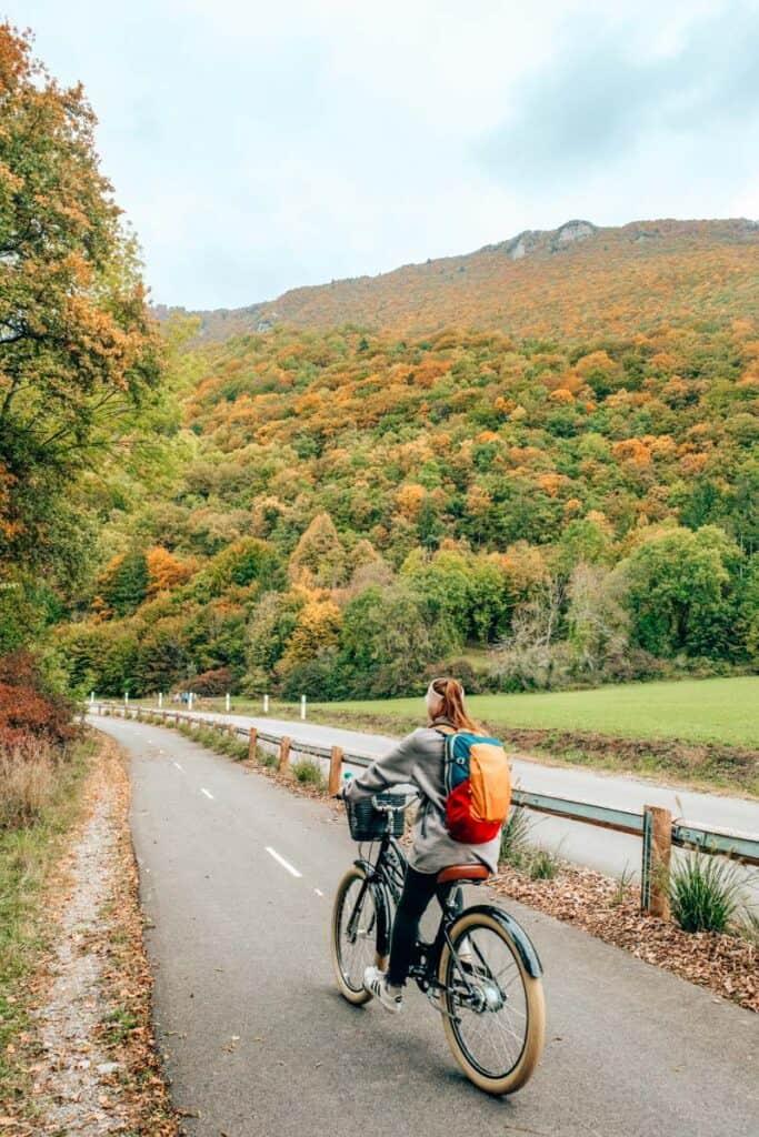 girl riding bike around Lake Annecy