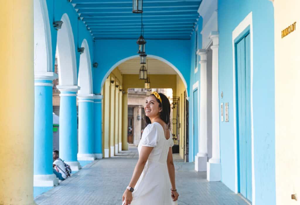 girl walking through blue building
